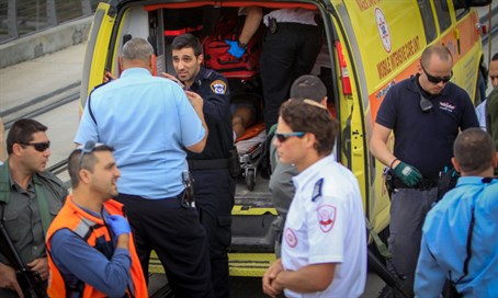 Illustrative: wounded loaded into ambulance after terror attack