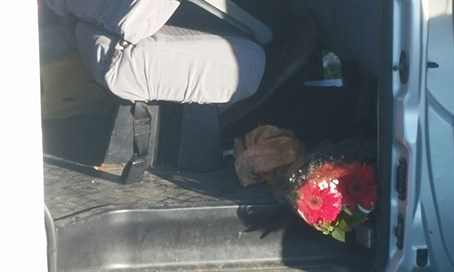 Flowers lay strewn inside the victims' car