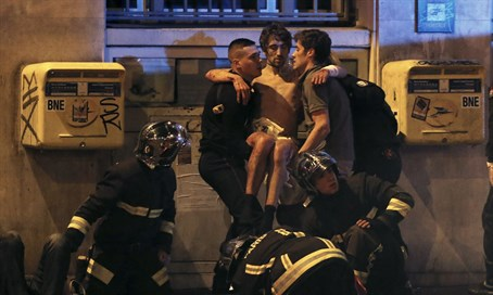 French firefighters aid injured victim of Paris attacks