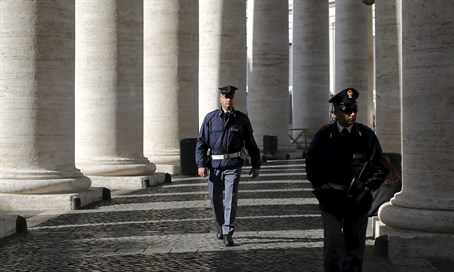 Italian police officers patrol the Vatican