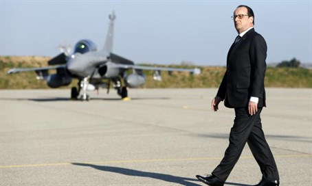 French PM Francois Hollande near jet (file)