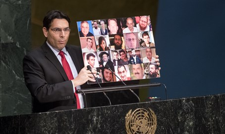 Danon holds up photo of Israeli terror victims