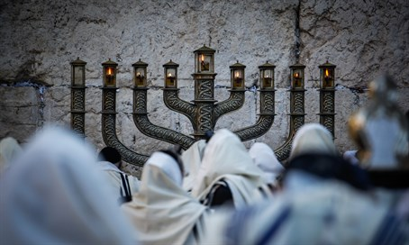 Hanukkah lighting at the Kotel - traditionally a men-only affair
