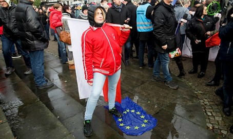 Woman stamps on EU flag