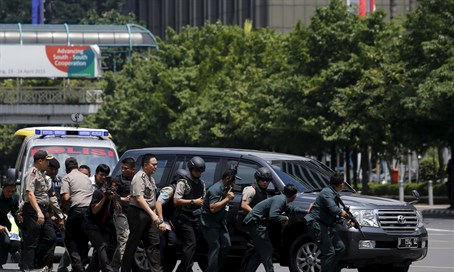 Jakarta Police take cover during attack on Thursday