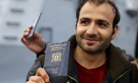 Syrian refugee holds passport (illustration)