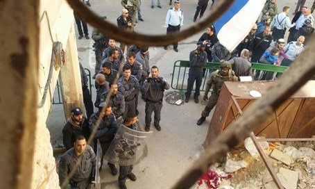 Security forces enter one of the buildings