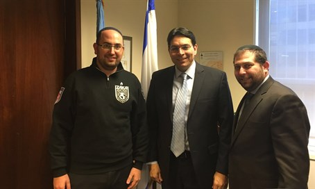 ZAKA members with Danny Danon