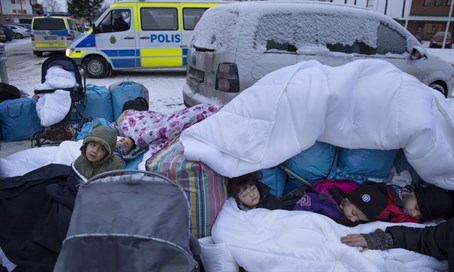 Children from Syria sleep outside the Swedish Migration Board