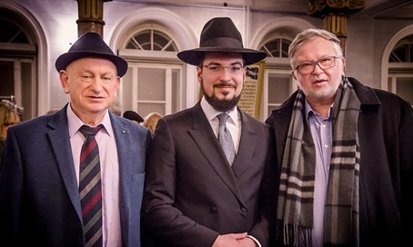 Rabbi Isaacson and two community members at the Main Shul in Vilna