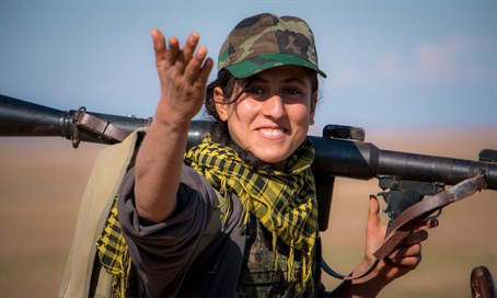 Female Kurdish YPG fighter gestures during fighting with ISIS in Syria (file)
