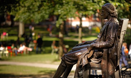 The Statue of Harvard University's first benefactor, John Harvard, sits in Harvard Yard