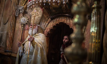 Armenian priest exists Jesus' Tomb at the Church of the Holy Sepulchre