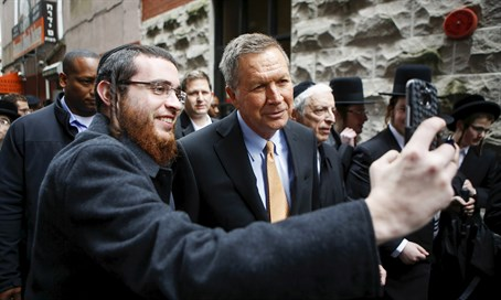 Haredi man takes a selfie with Republican candidate John Kasich in New York