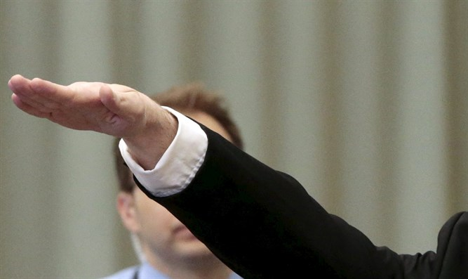Anders Behring Breivik gives Nazi salute to court