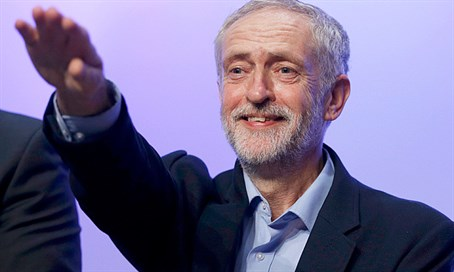 Jeremy Corbyn waves to supporters at rally