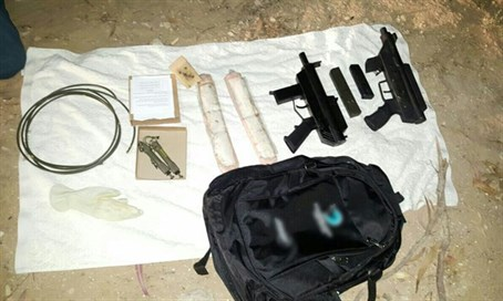Guns, drugs confiscated in raid