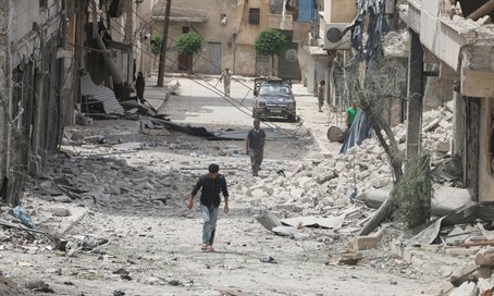 Residents walk through rubble in worn-torn Aleppo