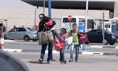 A. entering sovereign Israel with children after rescue