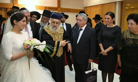 Rabbi Yitzhak Yosef with his daughter