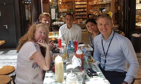 Australian Ambassador Dave Sharma (C) joins hosts embassy staff at Tel Aviv's Sarona Marke