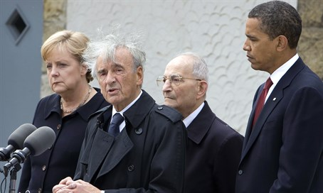 Elie Weisel speaks at Buchenwald concentration camp, flanked by US President Obama, German
