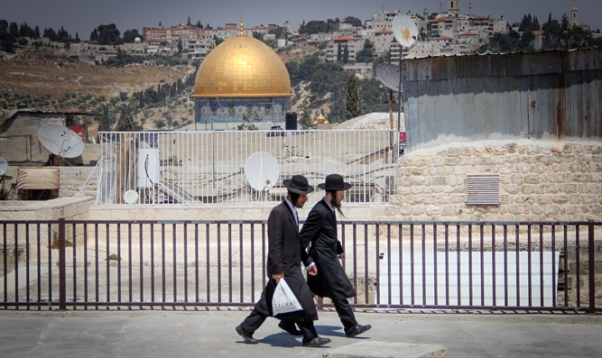 Haredi Jews walk close to the Temple Mount in Jerusalem