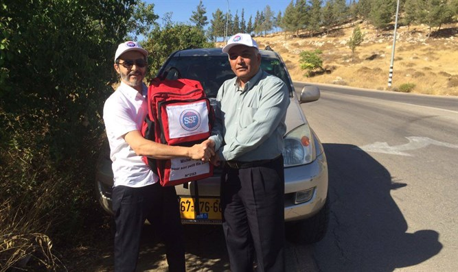 Dr. Ali Abu Sharach with Rescuers Without Borders Chairman Arie Levy