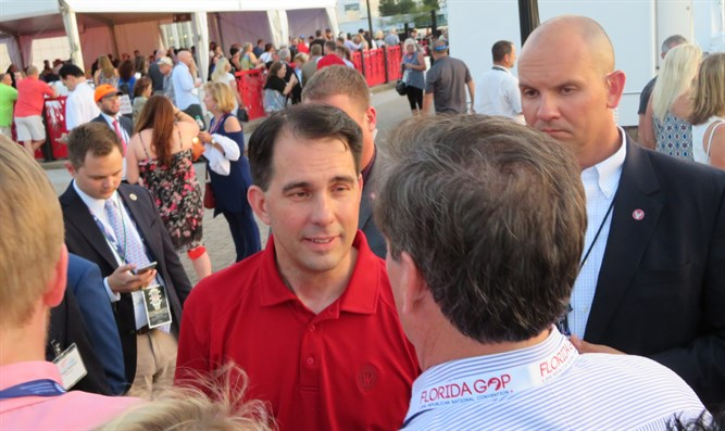 Wisconsin Gov. Scott Walker greeting attendees at the opening bash of the Republican Natio