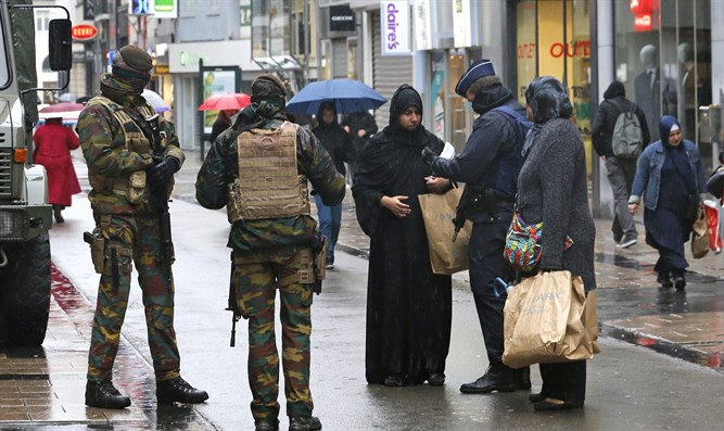 Belgian soldiers and armed police patrol central Brussels (file image)