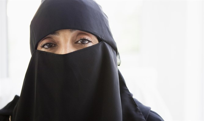 Muslim woman in face veil