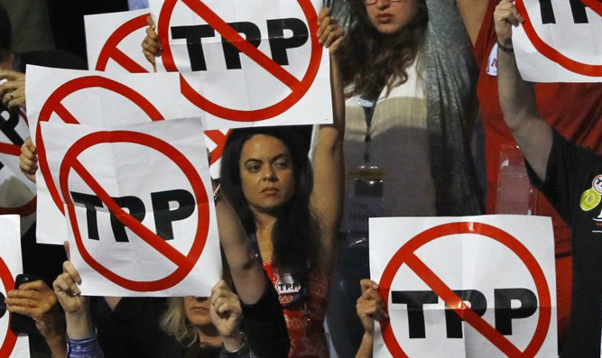 Delegates hold anti-Trans-Pacific Partnership signs during the Democratic National Convent