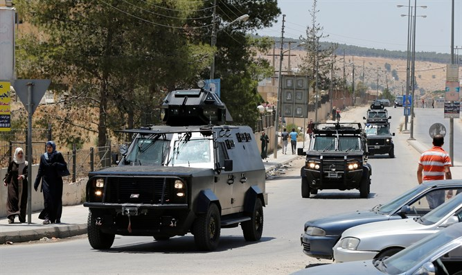 Security vehicles near Baqaa