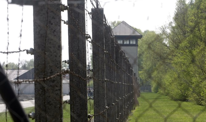 Barbed wire surrounds the site of Dachau concentration camp