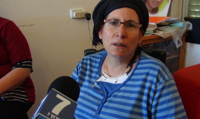 Rina Ariel, mother of Hallel-Yaffa Ariel, celebrates the plans for a new neighborhood