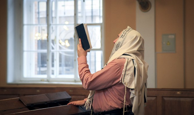 Jewish man prays at Chabad center