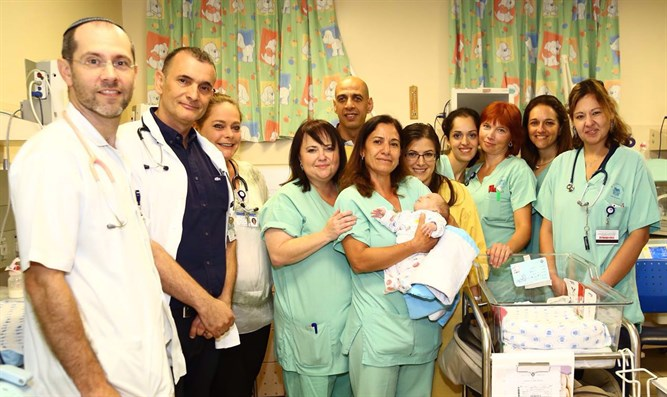 The happy parents with the Ichilov neonatal team