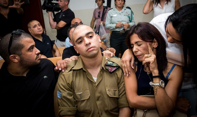 Elor Azariya sits with his family at his trial