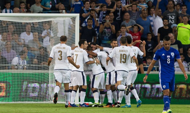 Italy celebrates one of their goals as a dejected Beram Kayal (8) walks away.
