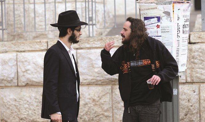 A haredi Jew and a secular Jew talk in Jerusalem