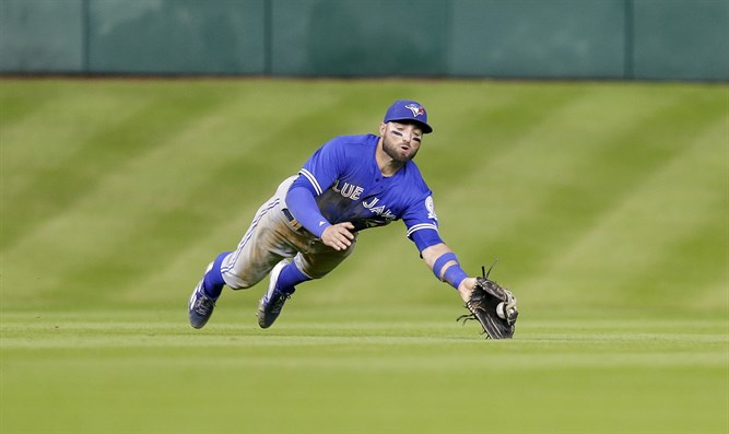 Kevin Pillar making a diving catch in a game against the Houston Astros in Houston, Aug. 3