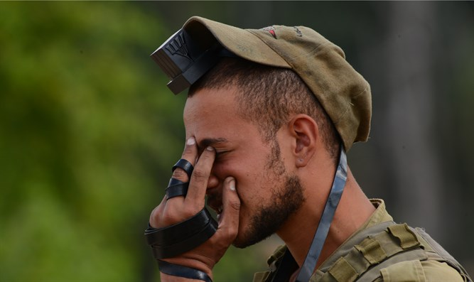 Soldier prays near Gaza