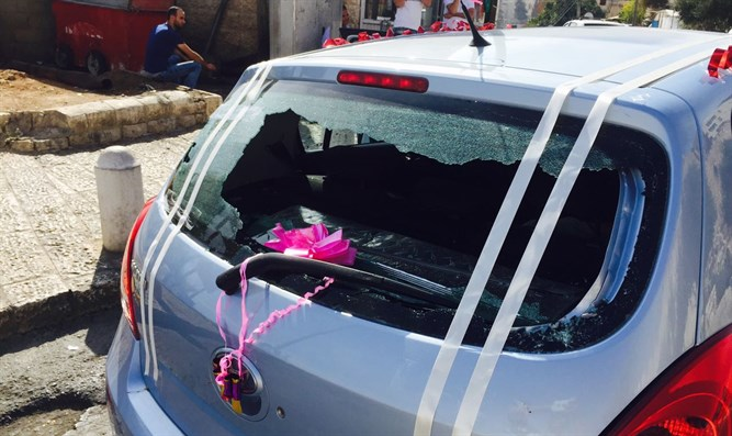 Vandalized car of visitor to Mount of Olives