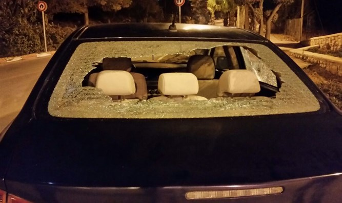 Car damaged by stones