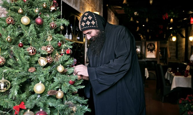 Monk with Christmas tree