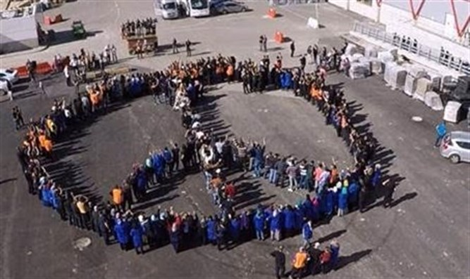 'SodaStream' factory workers form peace sign