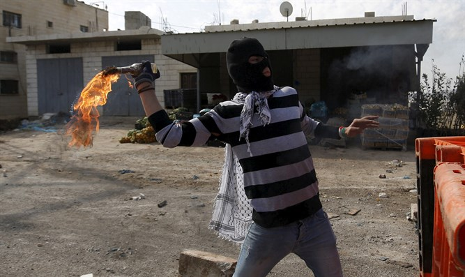 Arab throwing a firebomb (illustrative)