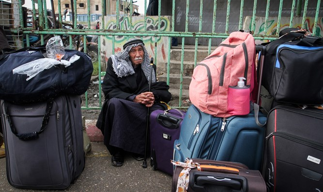 Gazans wait to cross into Egypt through Rafah border crossing