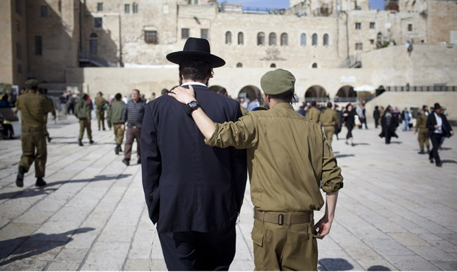 Haredi man and soldier at the Kotel