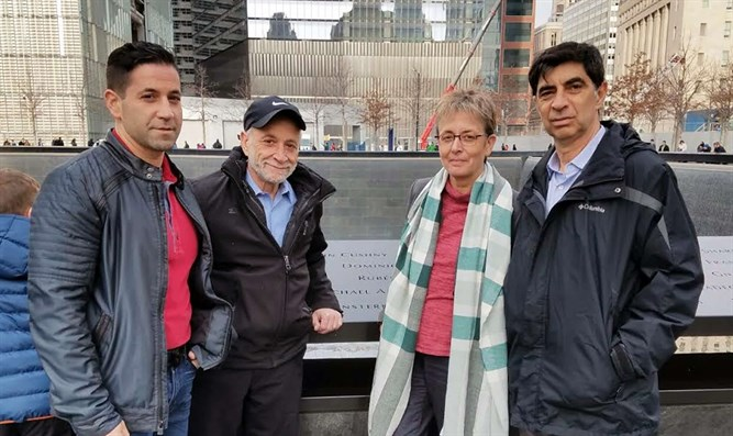 Jeffrey and Harvey Morgenstern with Leah and Simcha Goldin at the 9/11 Memorial in lower M